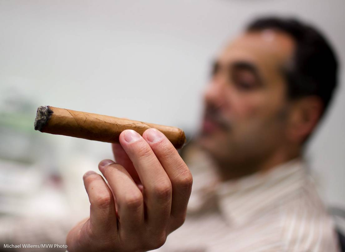 Cigar and person